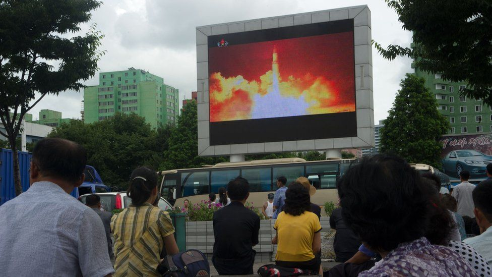 People in the North Korean capital Pyongyang watch coverage of an ICBM missile test on July 29, 2017