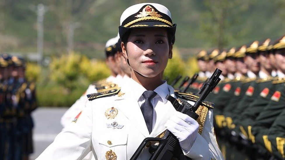 A female soldier from the Chinese People's Liberation Army attends a training session for the September 3 military parade to mark the 70th anniversary of the victory of the Chinese People's War of Resistance Against Japanese Aggression at a military base on August 22, 2015 in Beijing, China.