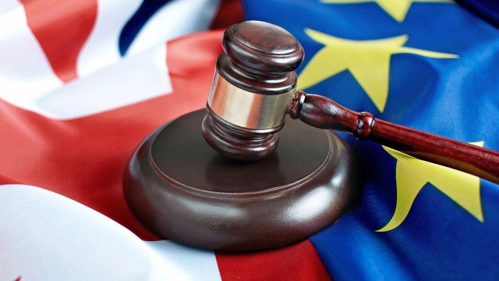 Gavel on UK and EU flags