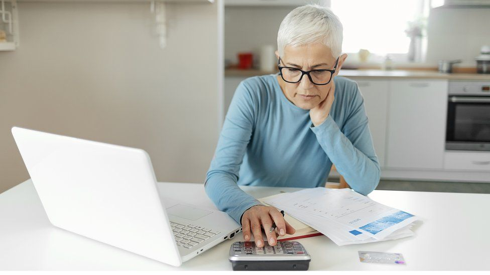 A woman using a calculator