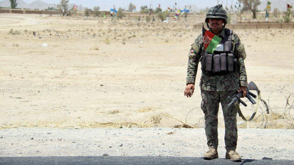 lone soldier at side of road