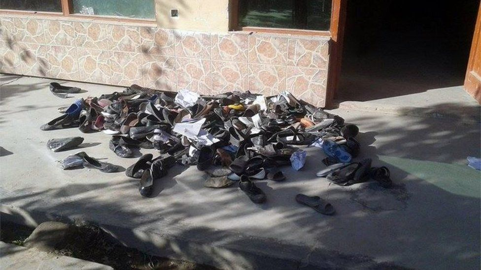 The abandoned shoes of Afghan schoolgirls involved in a deadly stampede are seen outside a school following an earthquake in Takhar Province (October 26, 2015)