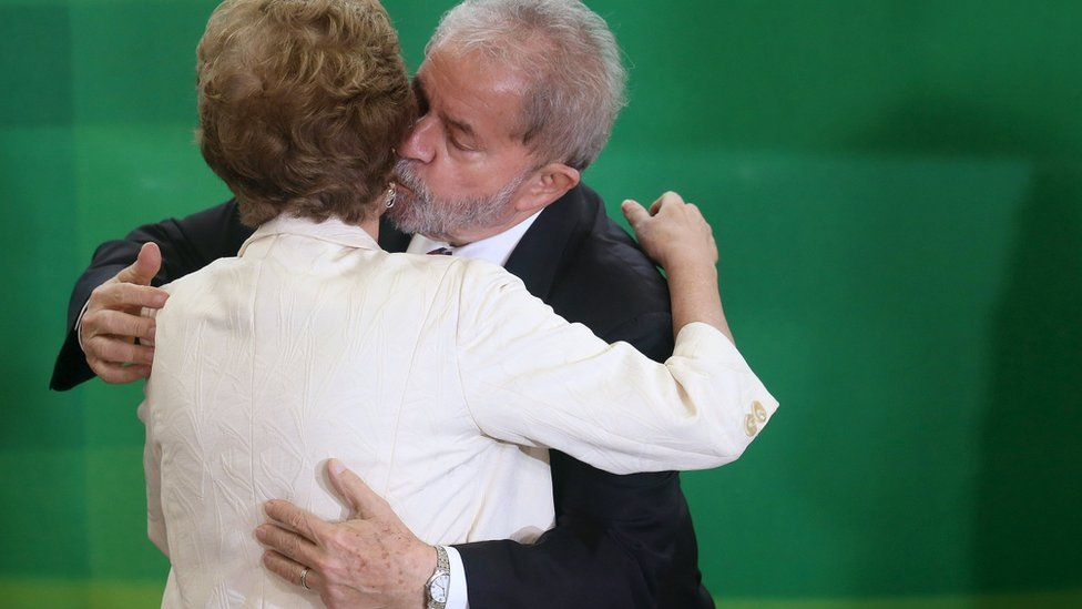 Brazi's President Dilma Rousseff greets former president Luiz Inacio Lula da Silva during his appointment as chief of staff, at Planalto palace in Brasilia on 17 March