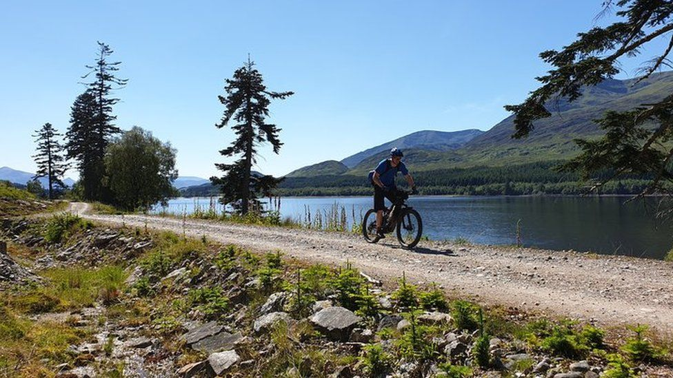 A cyclist on the Great North Trail in Loch Lomond and the Trossachs National Park