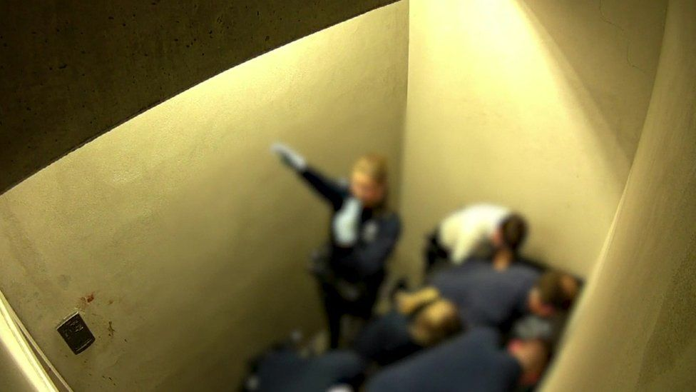 A still of video footage from Jozef Chovancova's cell, showing a police officer giving a Nazi salute
