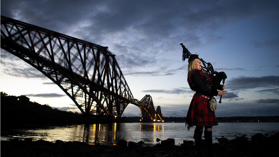 "Piper Louise Marshall, wearing a special commemorative red tartan, plays Battle""s O""er, the traditional Scottish lament played at the end of battle, at dawn alongside the Forth Bridge at North Queensferry on the 100th anniversary of the signing of the Armistice which marked the end of the First World War"