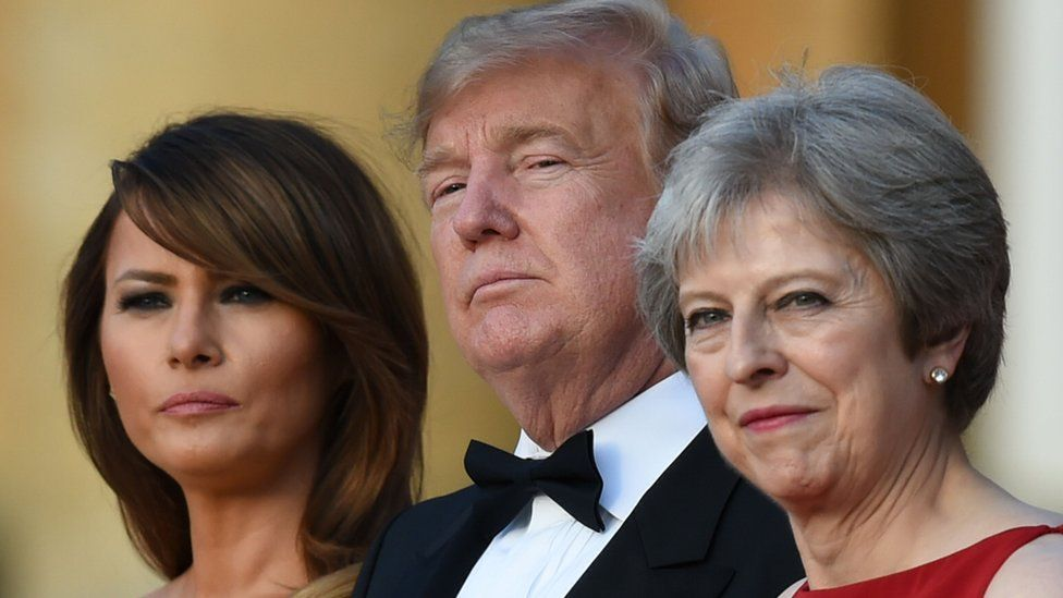 First Lady Melania Trump, her husband and Theresa May are pictured on the steps of Blenheim Palace on July 12, 2018