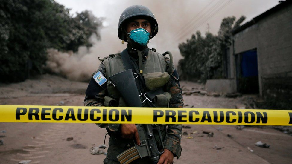 A soldier keeps watch at a restricted area affected by an eruption from Fuego volcano in the community of San Miguel Los Lotes in Escuintla, Guatemala, June 4, 2018