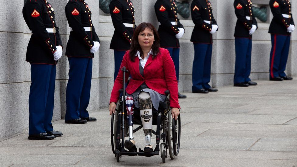 Tammy Duckworth arrives at a World War II Memorial ceremony in 2010, pictured in a wheelchair