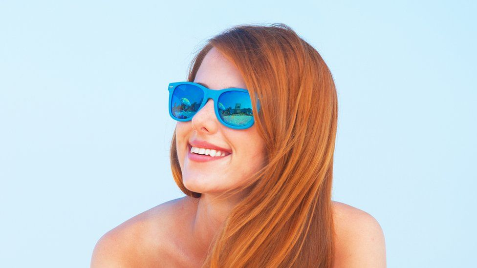 Red head in the sun