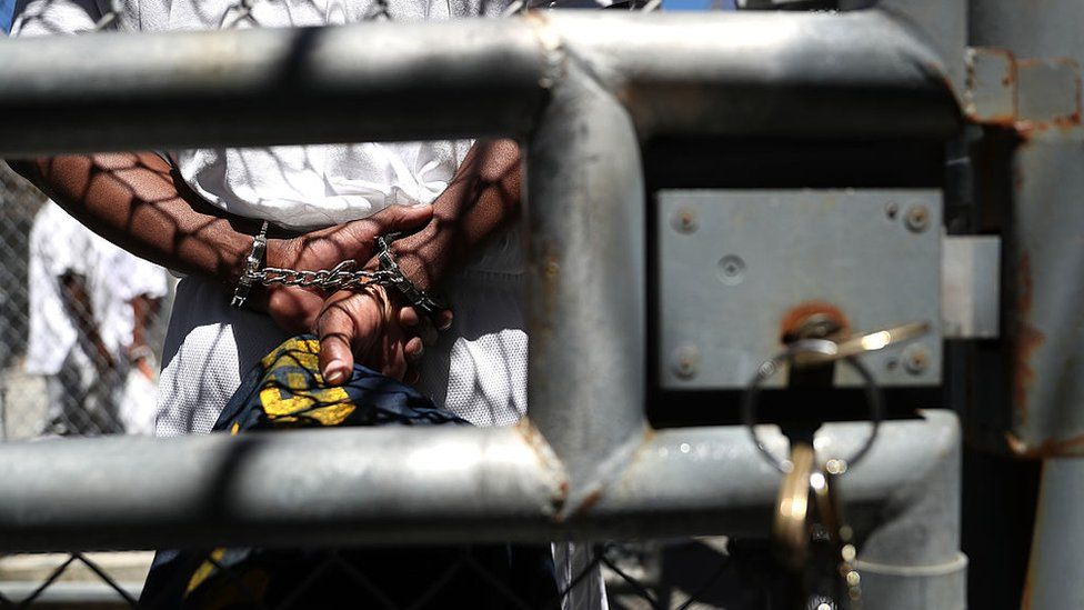A condemned inmate stands with handcuffs on as he preapres to be released from the exercise yard back to his cell at San Quentin State Prison's death row on August 15, 2016 in San Quentin, California