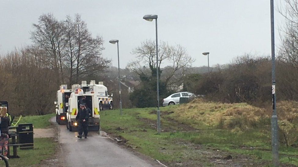 At least four police Land Rovers are attending