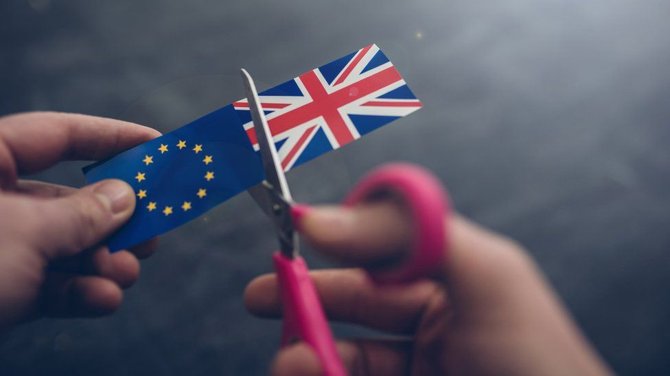 Cutting apart UK and EU flags