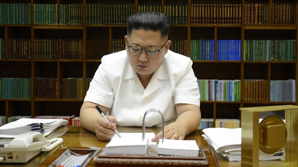 """July 27, 2017 picture released from North Korea""""s official Korean Central News Agency (KCNA) on July 29, 2017 shows North Korean leader Kim Jong-Un signing documents for test launch of an intercontinental ballistic missile (ICBM)"""