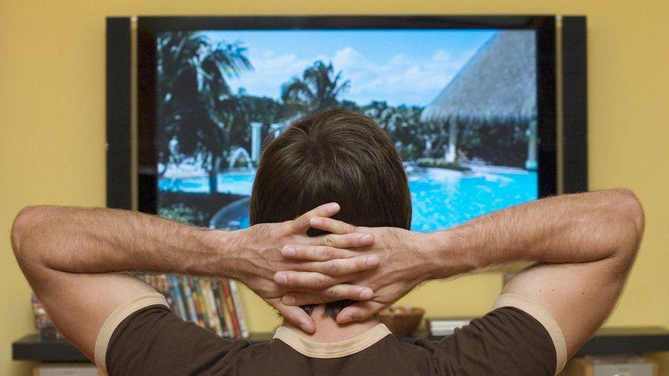 Person watching big TV set