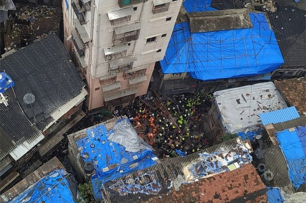 Rescue workers search for survivors at the site of a collapsed building in Mumbai, India, July 16, 2019.