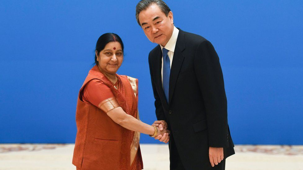 Indian Foreign Minister Sushma Swaraj (L) shakes hands with Chinese Foreign Minister Wang Yi before a meeting of foreign ministers and officials of the Shanghai Cooperation Organisation (SCO) at the Diaoyutai State Guest House in Beijing on April 24, 2018.