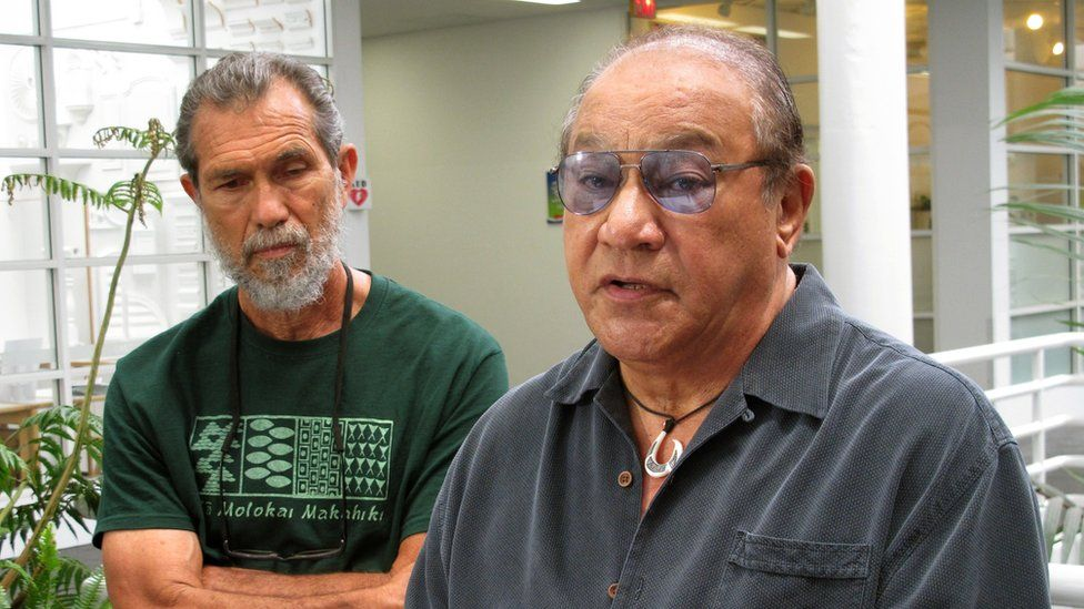In this April 3, 2015 file photo, Office of Hawaiian Affairs trustee Peter Apo, right, speaks to reporters in Honolulu, as activist Walter Ritte listens.