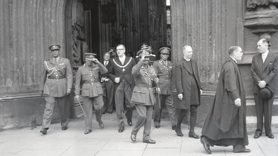 Haile Selassie leaving Bath Abbey to meet crowds, October 1954