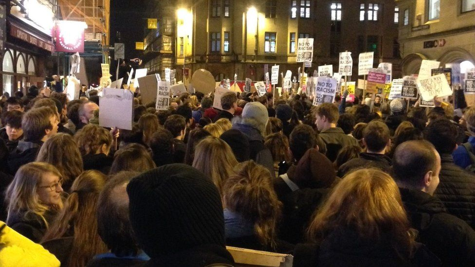 Protesters holding placards in central Oxford, Cornmarket St (30 January)