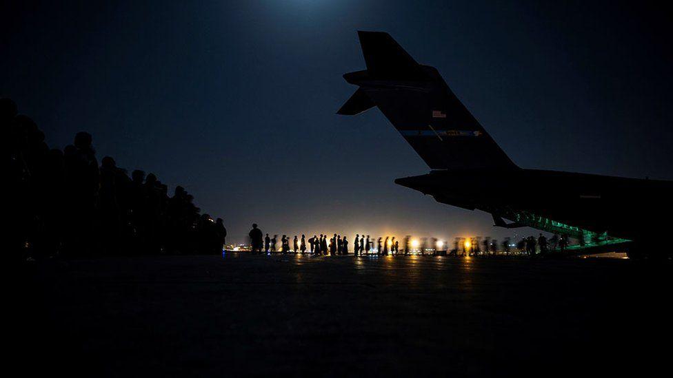 Evacuees board a US Air Force C-17 Globemaster III aircraft