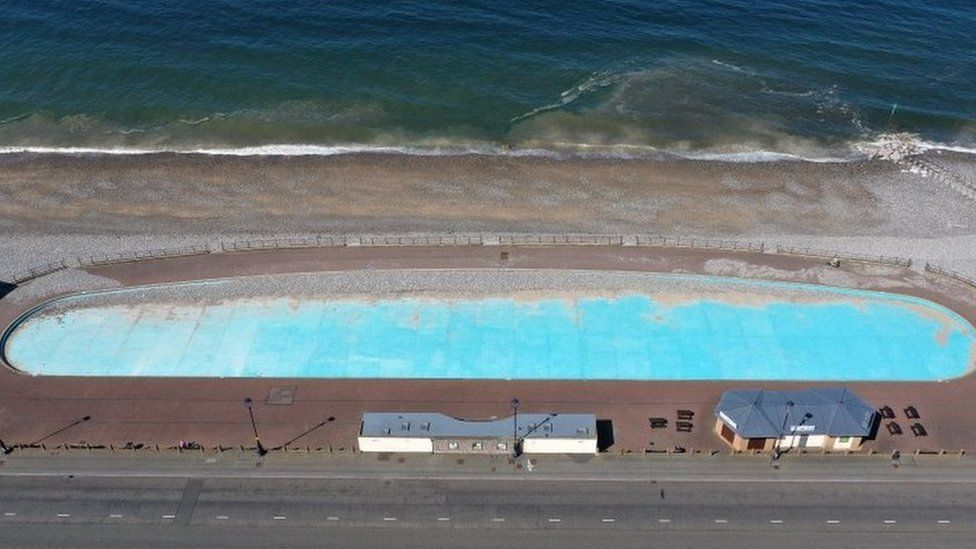 An empty paddling pool along the seafront in Llandudno, Conwy