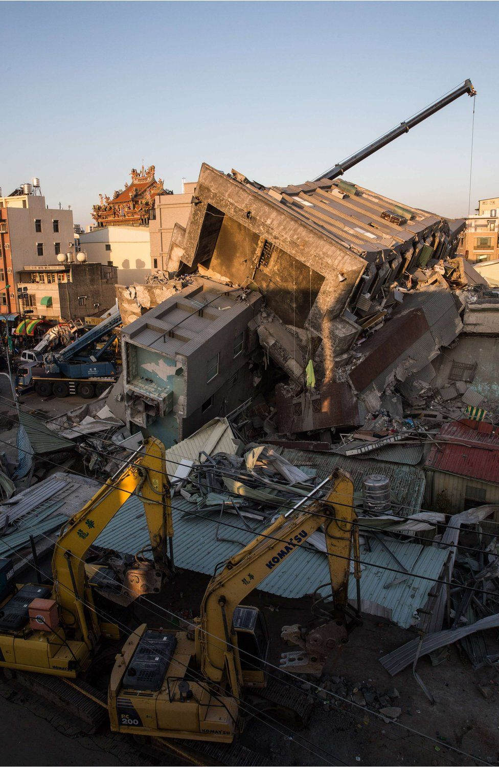 Cranes at the site of the collapsed building in Tainan, Taiwan (8 Feb 2016)
