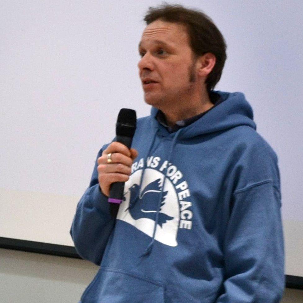 """Lee in a """"veterans for peace"""" hoodie"""