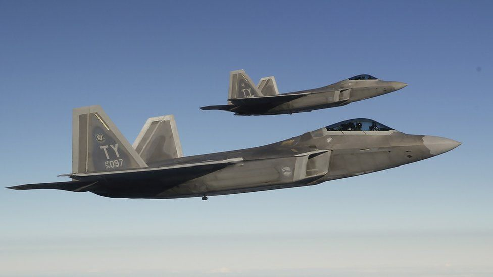 Two F-22 Raptor fighter jets approach a refuelling aircraft as they fly towards the newly established NATO airbase of Aemari, Estonia, in this file photo taken 4 September 2015