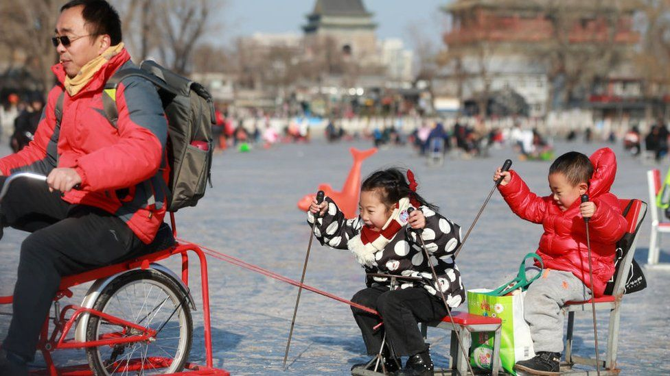 A Chinese man with two children in Beijing