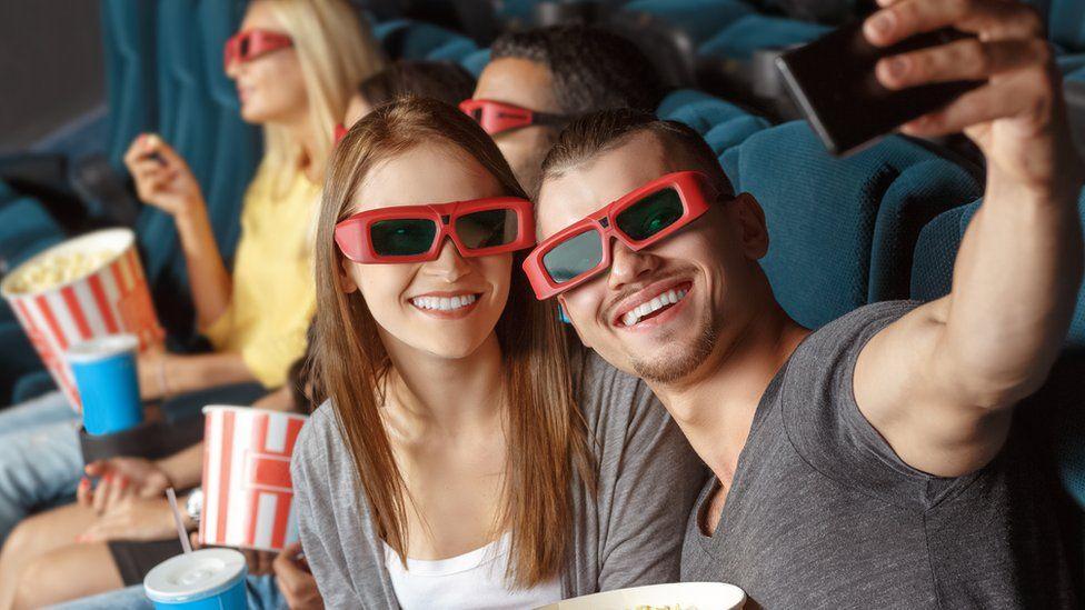 People taking a selfie in the cinema