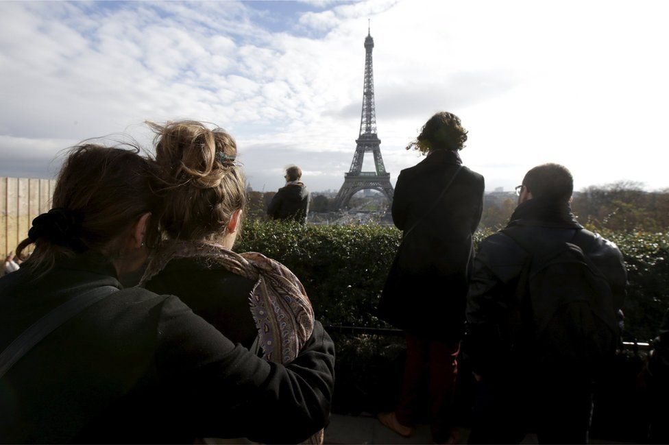 People observe a minute of silence at the Trocadero in front the Eiffel Tower