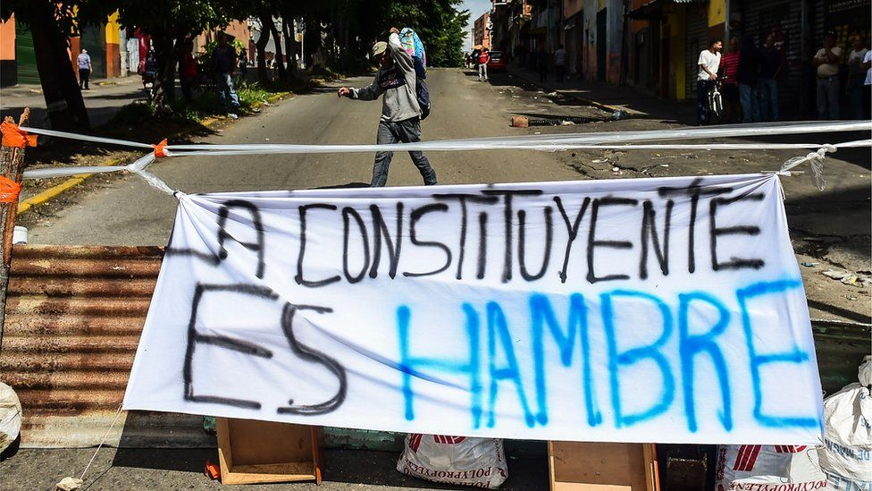 A banner placed by anti-government activists against President Nicolas Maduro's Constituent Assembly reading 'The Constituent Means Hunger,' is seen in Caracas' Petare neighbourhood on July 26, 2017.