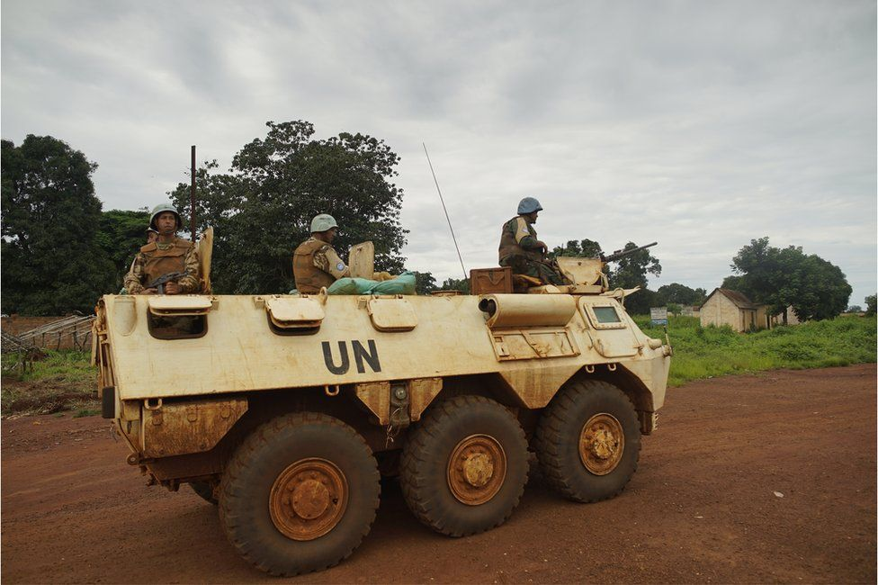 UN peacekeepers on patrol in an armoured tank