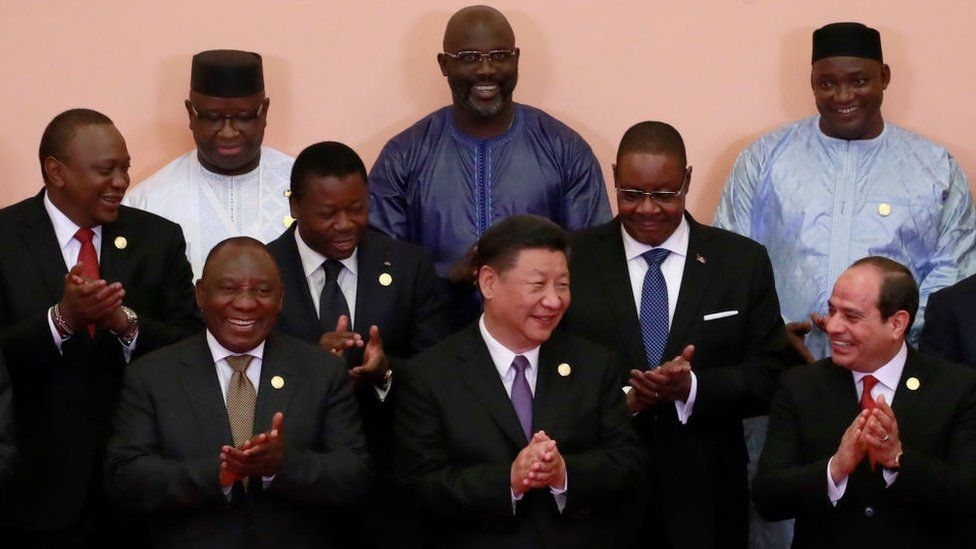 Chinese President Xi Jinping with African leaders clap during a group photo session during the Forum on China-Africa Cooperation