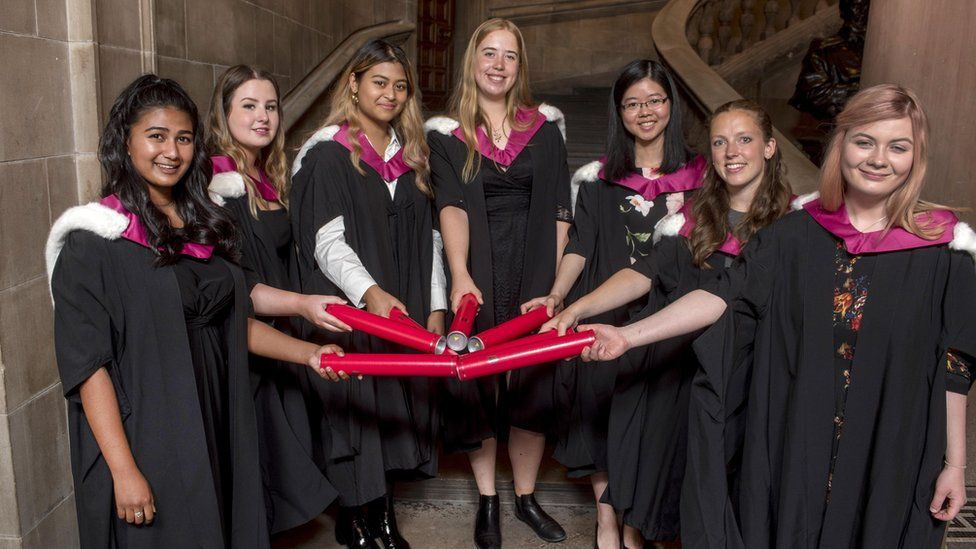 Students accept degrees