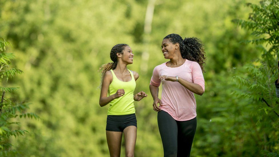 daughter and mother out running