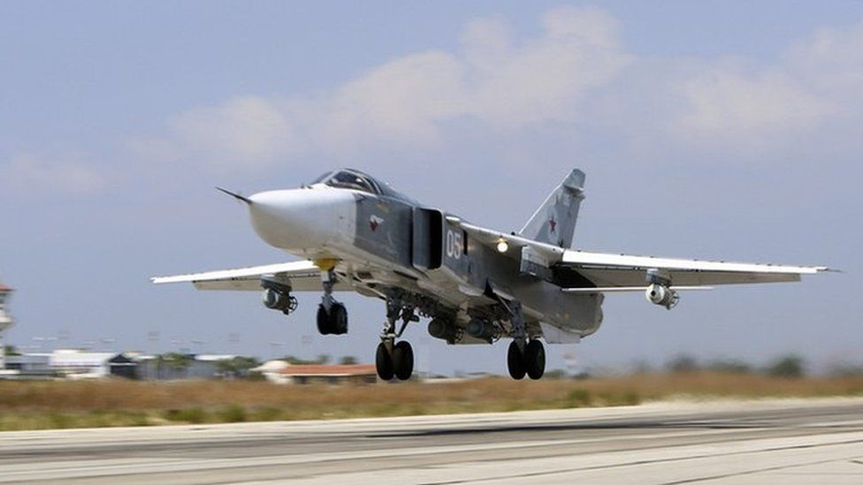 A Russian SU-24M jet fighter armed with laser guided bombs takes off from a runaway at Hmeimim airbase in Syria