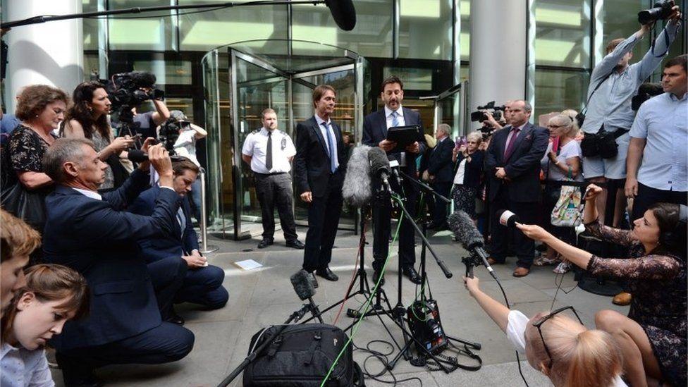Press gathered around Sir Cliff Richard and his lawyer Gideon Benaim