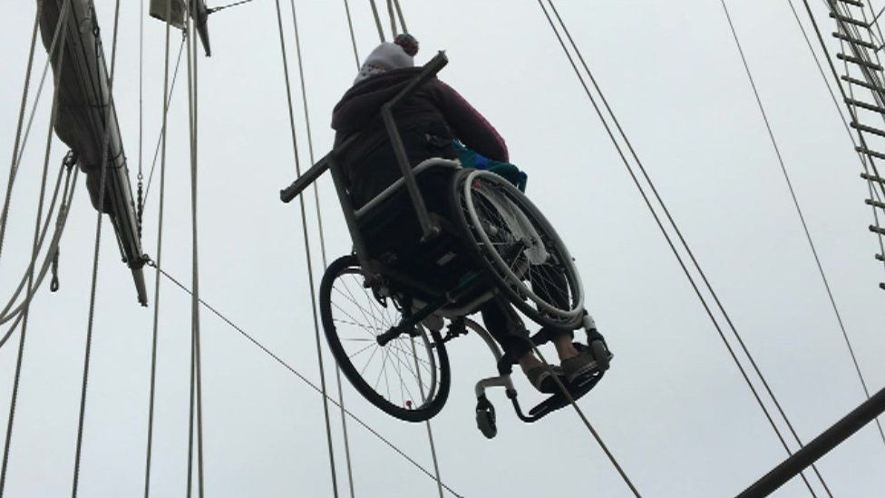 Wheelchair suspended on ropes on the Lord Nelson