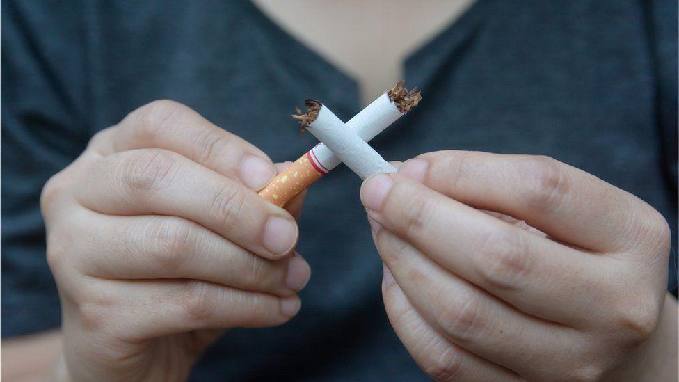 boy breaking a cigarette