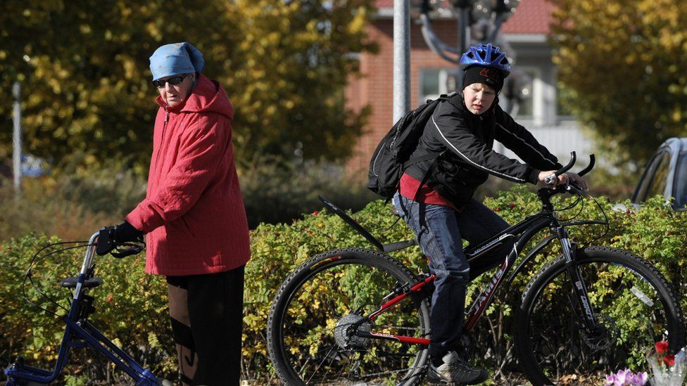 Old woman and young boy in Kauhajoki, southwestern Finland