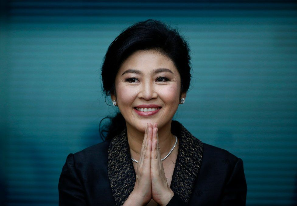 """Former Thai prime minister Yingluck Shinawatra greets supporters as she arrives to deliver closing statements in her trial for alleged criminal negligence over her government""""s rice-pledging scheme at the Supreme Court""""s Criminal Division for Persons Holding Political Positions in Bangkok, Thailand, 01 August 2017."""