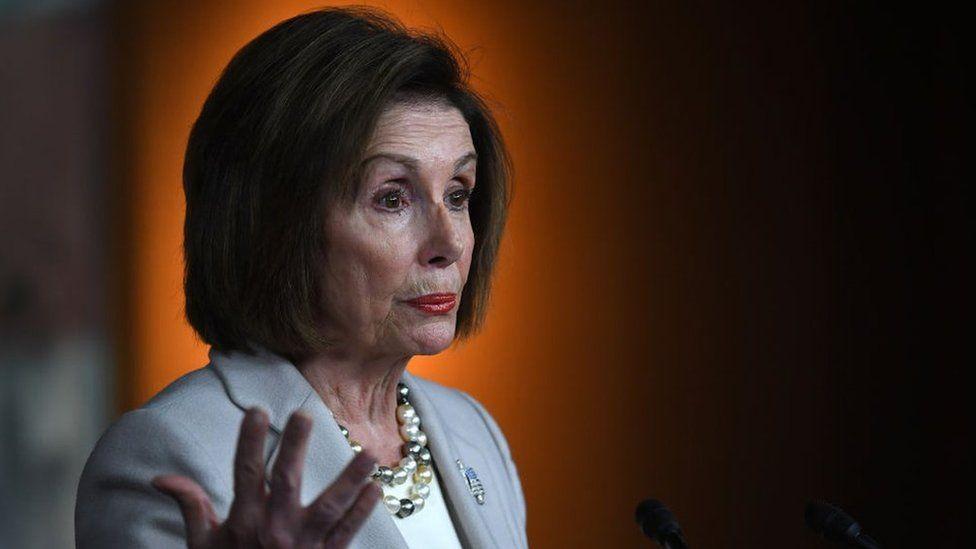 Nancy Pelosi gestures as she gives a speech in Washington DC