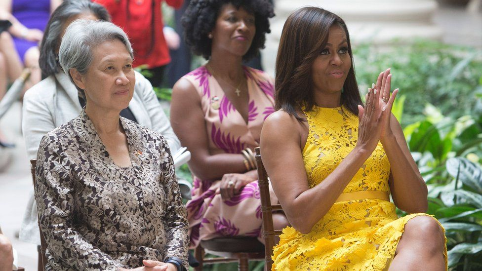 First Lady Michelle Obama and Ho Ching(L), wife of Singapore's Prime Minister Lee Hsien Loong watch a performance by students at the Turnaround Arts Summer Program