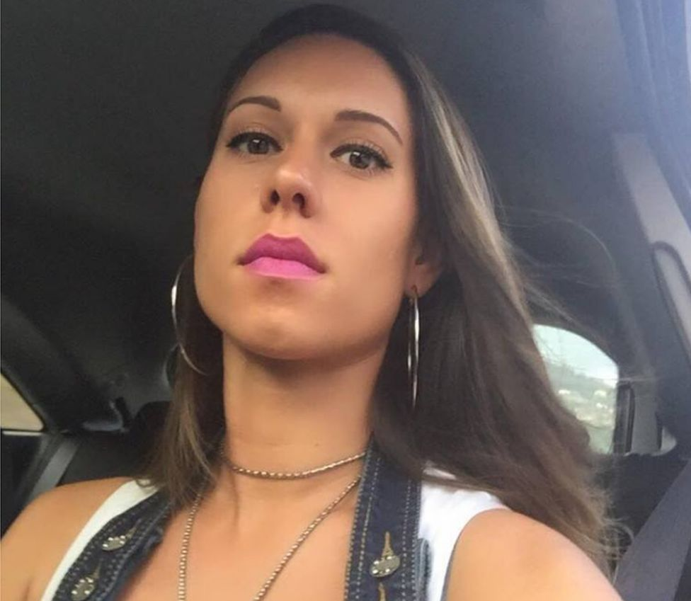 A selfie posted by Elisa Bozzo last year shows her sitting in a car in pink lipstick