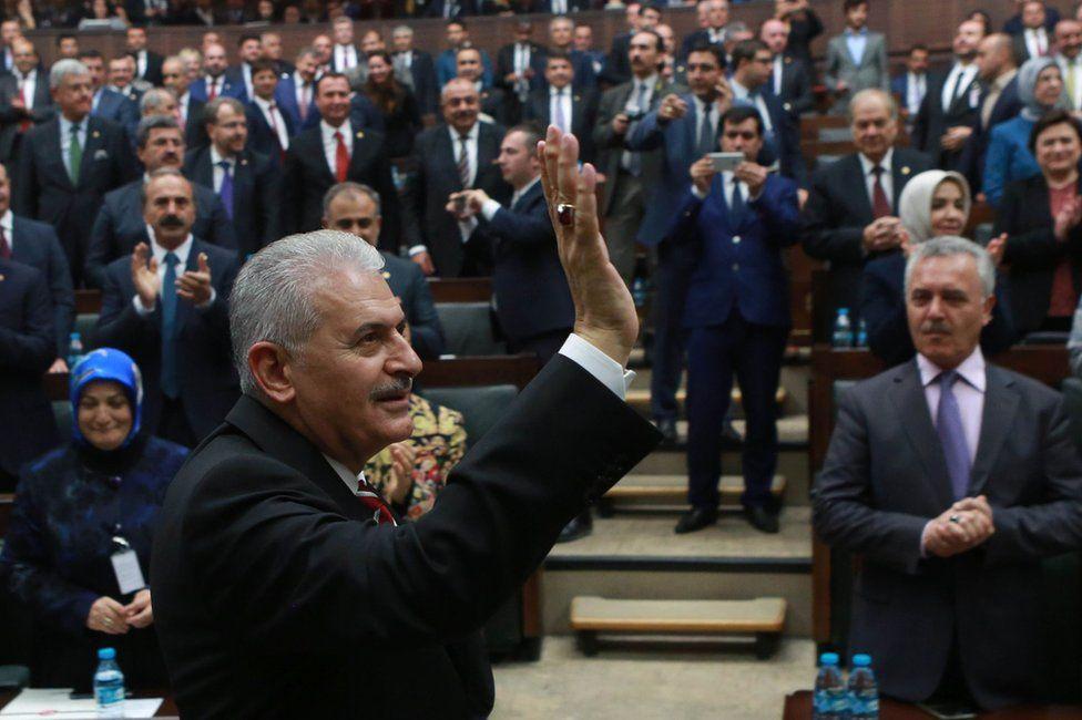 Turkish Prime Minister Binali Yildirim waves at a meeting of AKP MPs in Ankara, 8 November