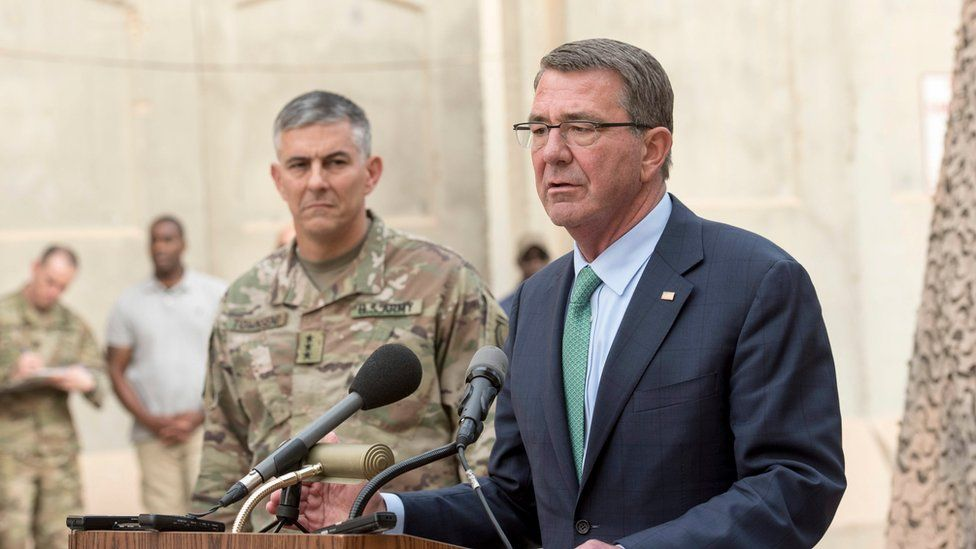 Office of the Secretary of Defense handout shows US Secretary of Defense Ash Carter (R) and US Army Lt. Gen. Stephen Townsend, commander of Combined Joint Task Force-Operation Inherent Resolve, host a press conference at the task force's headquarters in Baghdad, Iraq, 22 October 2016.