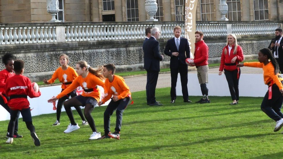Prince Harry watching children play rugby
