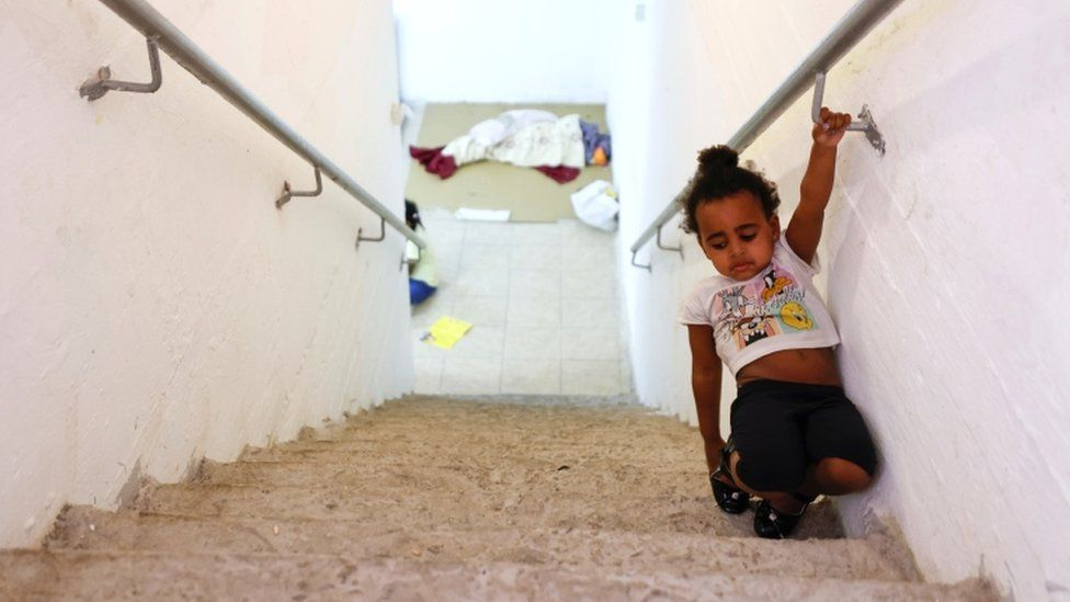 A child walks on stairs inside a bomb shelter in Ashkelon, southern Israel, on May 16